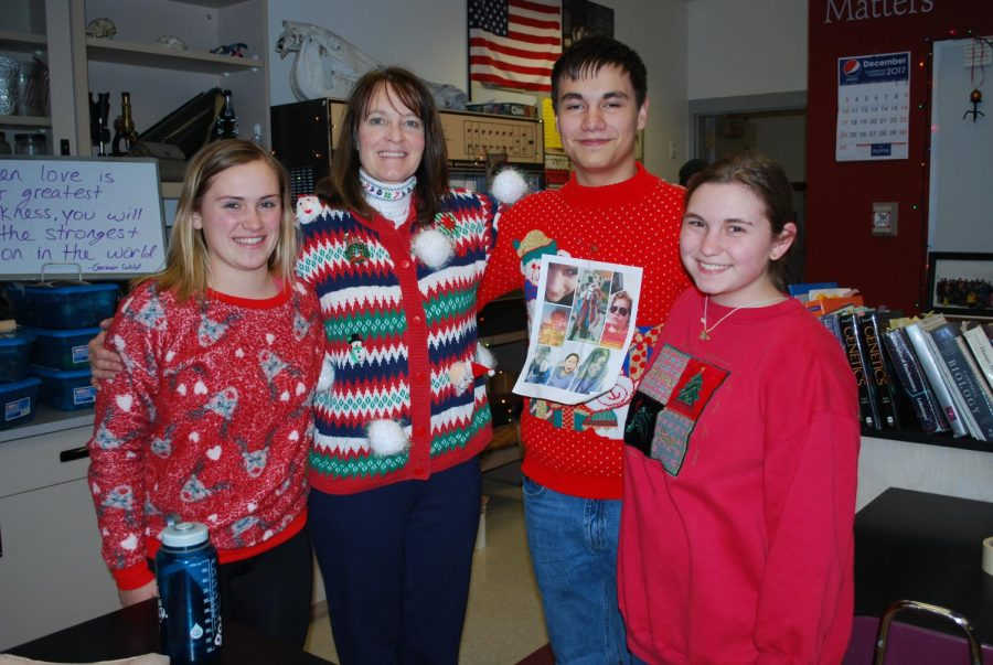 Alex+Fasbender%2C+Mrs.+Ladd%2C+Bryce+Rives%2C+and+Gwen+Roszel+come+together+to+share+their+Christmas+spirit+with+these+creative+ugly+sweaters.