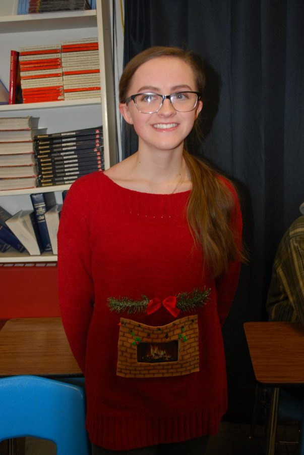 Emma Hoover shows her spirit with this lit sweater. She truly is roasting chestnuts over the open fire.