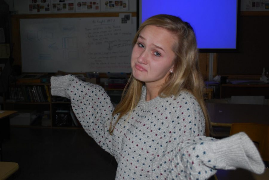 Madi Beason and her ugly sweater shows us all how to feel about still having one more day until Christmas break!