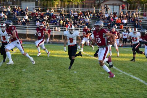 Kaden Huot (12) makes a run down the field.